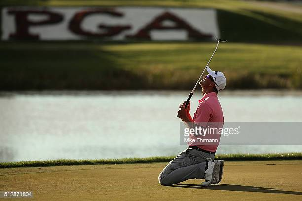 Adam Scott of Australia reacts to a missed putt on the 17th green during the final round of the Honda Classic at PGA National Resort Spa Champions...