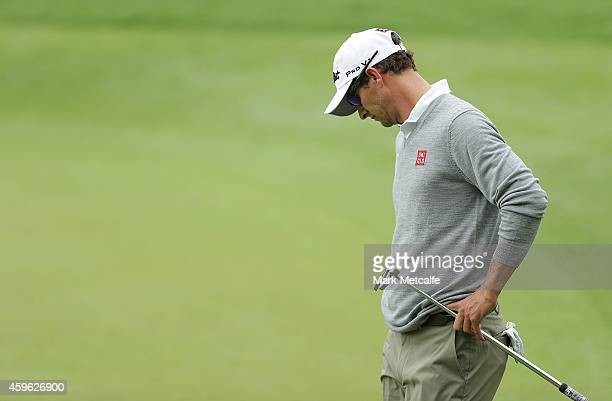 Adam Scott of Australia reacts to a missed putt on the 1st hole during day one of the 2014 Australian Open at The Australian Golf Course on November...