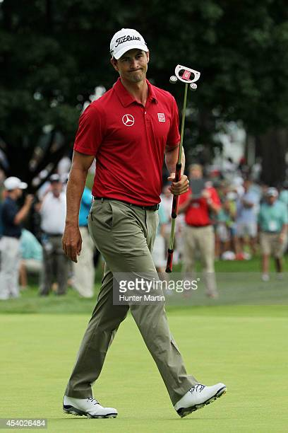 Adam Scott of Australia reacts to a putt on the 18th green during the third round of The Barclays at The Ridgewood Country Club on August 23 2014 in...