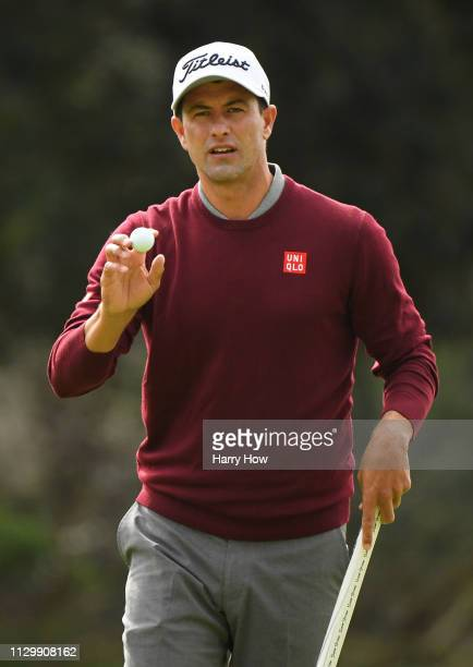 Adam Scott of Australia reacts to hitting a birdie on the 8th hole during the continuation of the first round of the Genesis Open at Riviera Country...