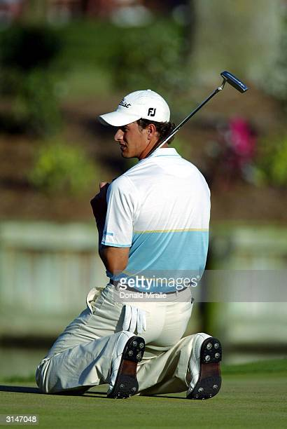 Adam Scott of Australia reacts to missed birdie putt on the 17th hole during the third round of the Players Championships at the TPC at Sawgrass on...