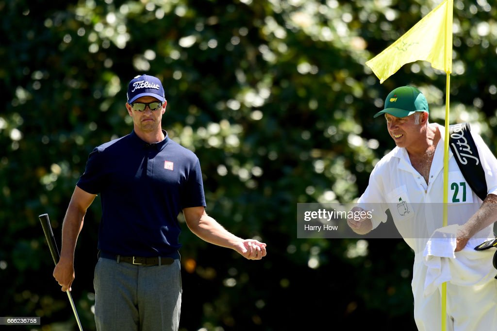 Adam Scott of Australia reacts with caddie Steve Williams on the first hole during the third round of the 2017 Masters Tournament at Augusta National Golf Club on April 8, 2017 in Augusta, Georgia.