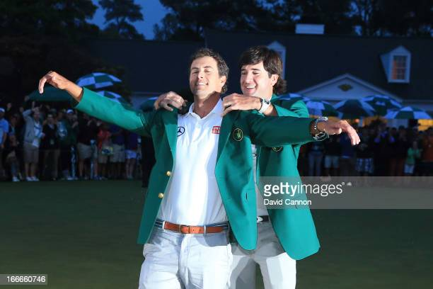 Adam Scott of Australia receives his green jacket from 2012 Masters champion Bubba Watson after Scott wins the 2013 Masters Tournament at Augusta...