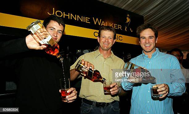 Adam Scott of Australia Retief Goosen of South Africa and Trevor Immelman of South Africa pose during the 'Golfers Behind the Bar' function at the...