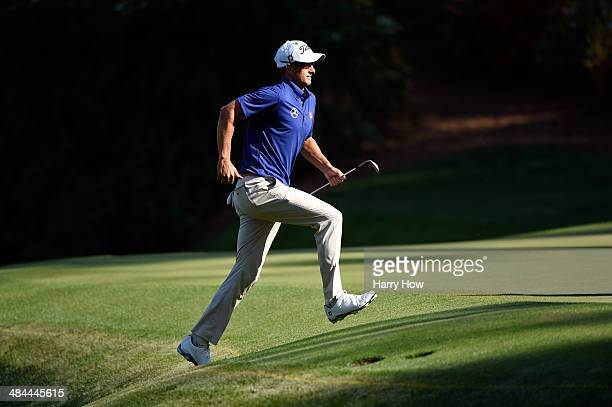 Adam Scott of Australia runs to the green after hitting his third shot on the 13th hole during the third round of the 2014 Masters Tournament at...