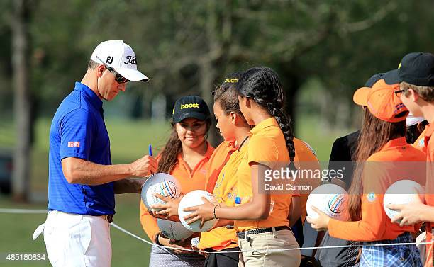 Adam Scott of Australia signing autographs for children during his practice round as a preview for the Cadillac Championship held on the Blue Monster...