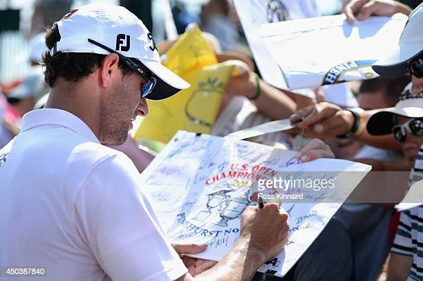 Adam Scott of Australia signs his autograph for fans during a practice round prior to the start of the 114th US Open at Pinehurst Resort Country Club...