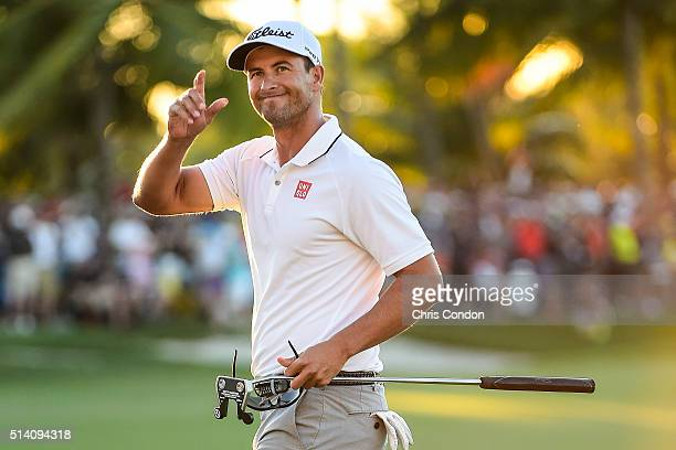 Adam Scott of Australia smiles and celebrates his one stroke victory on the 18th hole green during the final round of the World Golf...