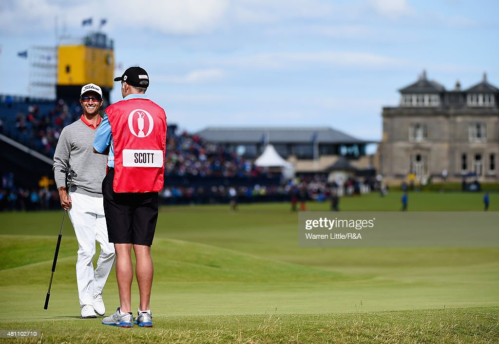 Adam Scott of Australia smiles at caddie Steve Williams on the 17th green during the second round of the 144th Open Championship at The Old Course on July 17, 2015 in St Andrews, Scotland.