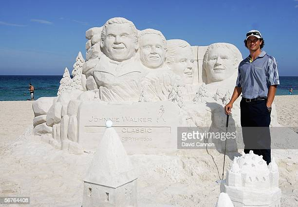 Adam Scott of Australia stands beside a 2 metre high sand sculpture featuring his likeness to launch the 2006 Johnnie Walker Classic on Cottesloe...