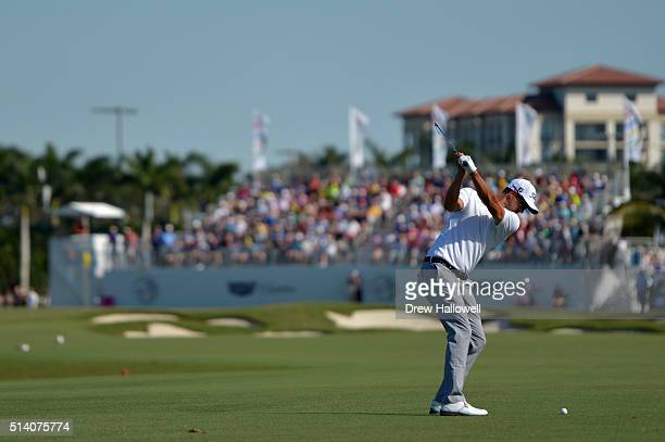 Adam Scott of Australia takes his second shot on the eighth hoel during the final round of the World Golf ChampionshipsCadillac Championship at Trump...