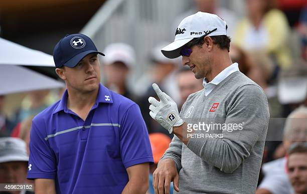 Adam Scott of Australia talks to Jordan Spieth of the US before teeing off on the 1st hole during the first round of the Australian Open at the...