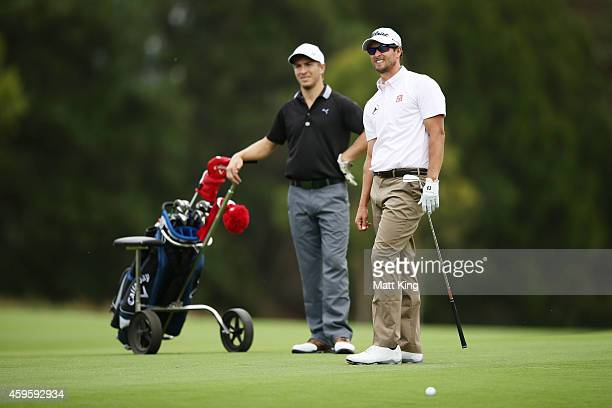 Adam Scott of Australia talks to Sydney Swans player Kieren Jack ahead of the 2014 Australia Open at The Australian Golf Course on November 26 2014...