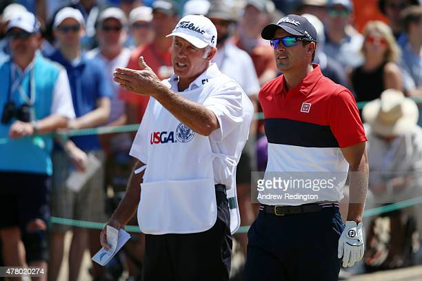 Adam Scott of Australia talks with caddie Steve Williams on the third tee during the final round of the 115th US Open Championship at Chambers Bay on...
