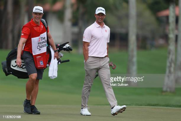 Adam Scott of Australia talks with his caddie on the third hole during the first round of the Honda Classic at PGA National Resort and Spa on...
