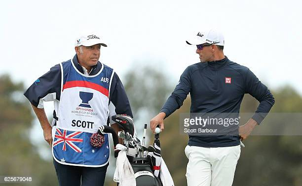 Adam Scott of Australia talks with his caddie Steve Williams during day two of the World Cup of Golf at Kingston Heath Golf Club on November 25 2016...
