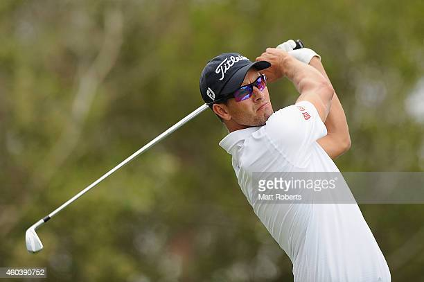 Adam Scott of Australia tees off on the 10th hole during day three of the 2014 Australian PGA Championship at Royal Pines Resort on December 13, 2014...