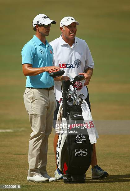 Adam Scott of Australia waits alongside caddie Steve Williams on the tenth hole during the first round of the 114th US Open at Pinehurst Resort...
