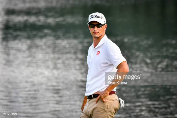 Adam Scott of Australia waits for play to end after carding a bogey on the 18th hole green during the first round of THE PLAYERS Championship on the...