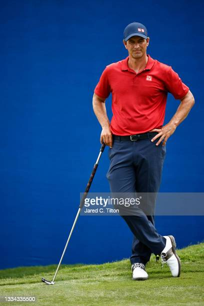 Adam Scott of Australia waits on the 18th green during the final round of the Wyndham Championship at Sedgefield Country Club on August 15, 2021 in...
