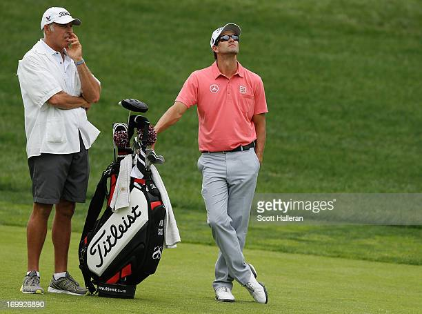 Adam Scott of Australia waits to play a shot during the final round of the Memorial Tournament presented by Nationwide Insurance at Muirfield Village...