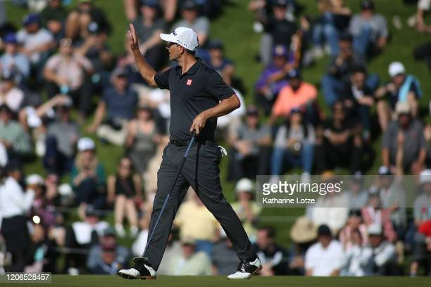 Adam Scott of Australia waives to fans after finishing the 18th hole during round three of the Genesis Invitational at the Riviera Country Club on...