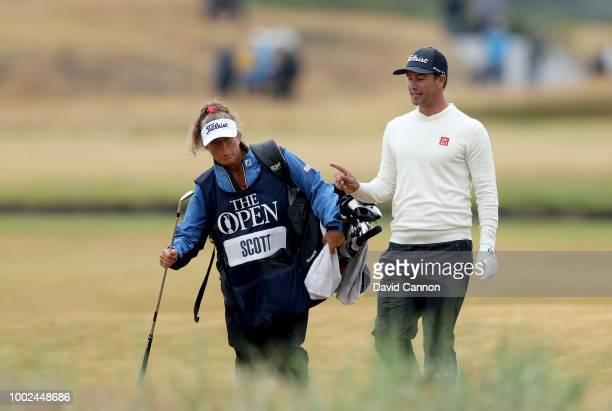 Adam Scott of Australia walks down the 18th hole with his caddie Fanny Sunesson of Sweden during the second round of the 147th Open Championship at...