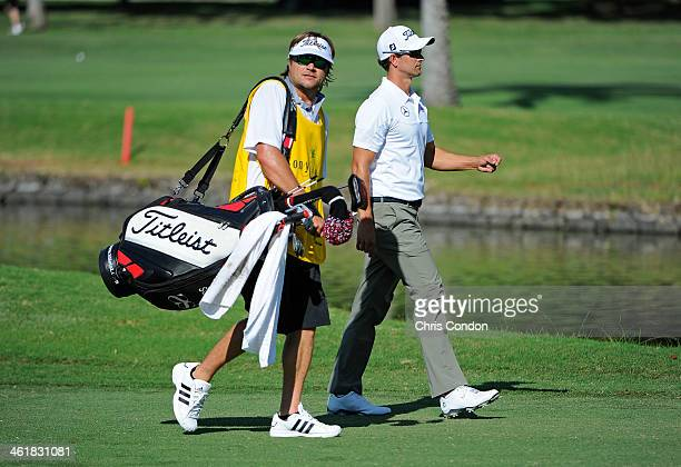 Adam Scott of Australia walks to the second green with caddie Benji Weatherley during the third round of the Sony Open in Hawaii at Waialae Country...