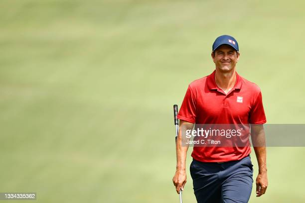 Adam Scott of Australia walks up the 18th fairway, the first-playoff hole in a six-way sudden-death playoff, during the final round of the Wyndham...
