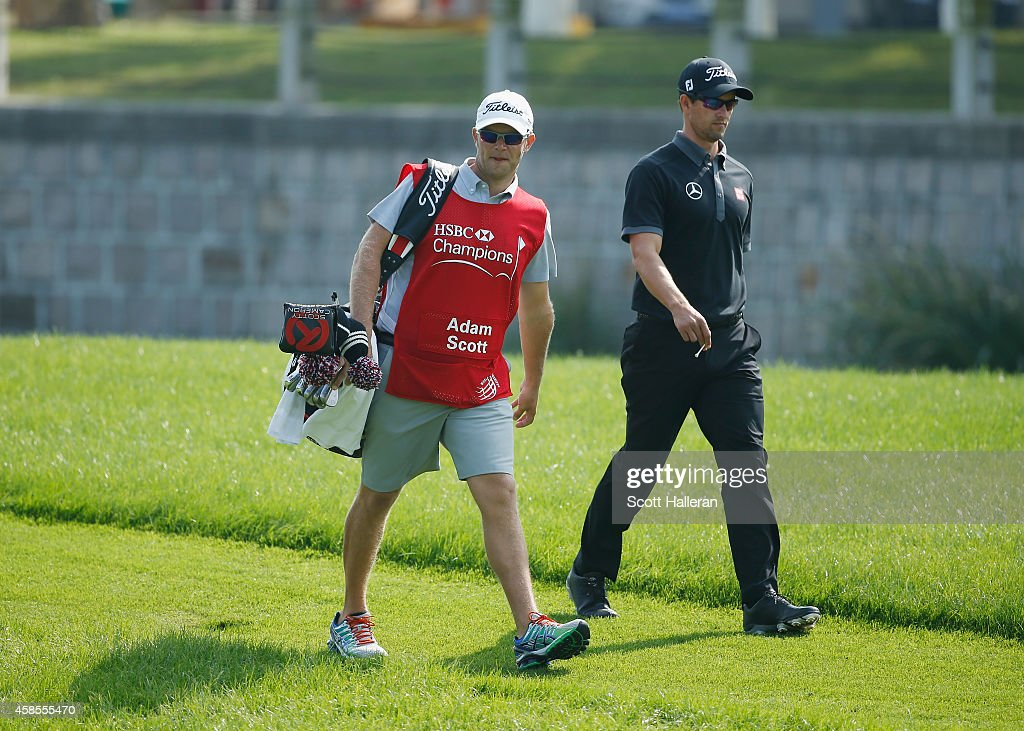 Adam Scott of Australia walks with his caddie David Clark on the fourth hole during the second round of the WGC - HSBC Champions at the Sheshan International Golf Club on November 7, 2014 in Shanghai, China.