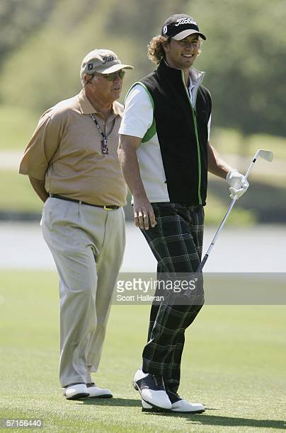 Adam Scott of Australia watched by his coach Butch Harmon during a practice round on the Stadium Course prior to The Players Championship at the...