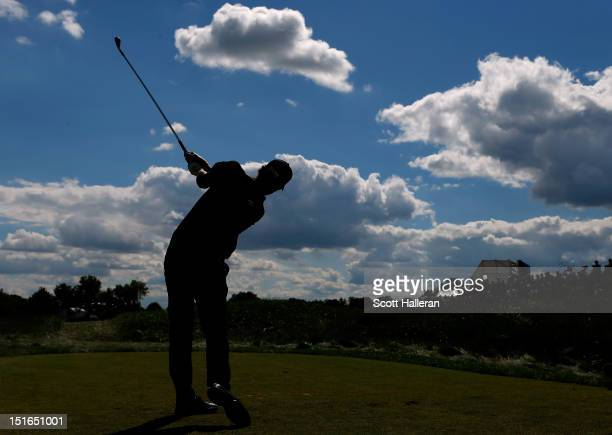 Adam Scott of Australia watches his tee shot on the 10th hole during the final round of the BMW Championship at Crooked Stick Golf Club on September...