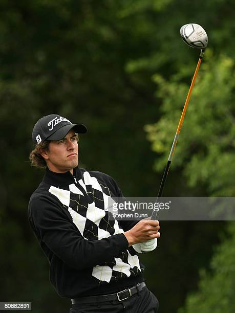 Adam Scott of Australia watches his tee shot on the 12th hole during the final round of the EDS Byron Nelson Championship at TPC Four Seasons Resort...