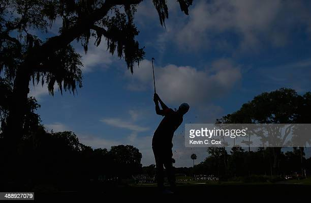 Adam Scott of Australia watches his tee shot on the 13th hole during the second round of THE PLAYERS Championship on The Stadium Course at TPC...