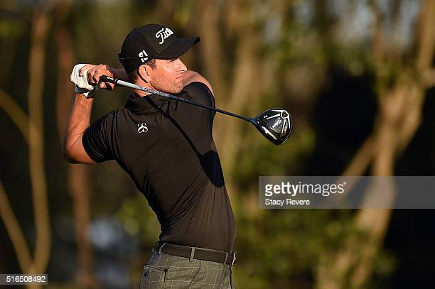Adam Scott of Australia watches his tee shot on the third hole during the third round of the Arnold Palmer Invitational Presented by MasterCard at...
