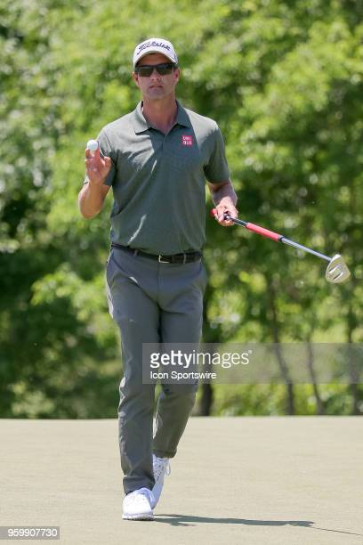 Adam Scott of Australia waves at the gallery after finishing his second round of the 50th anniversary AT&T Byron Nelson on May 18, 2018 at Trinity...