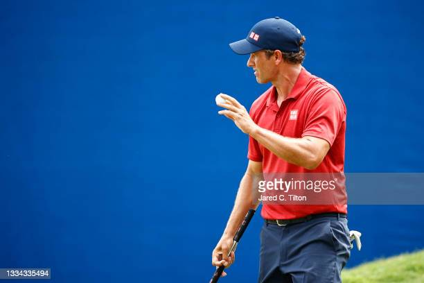 Adam Scott of Australia waves on the 18th green during the final round of the Wyndham Championship at Sedgefield Country Club on August 15, 2021 in...
