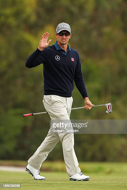 Adam Scott of Australia waves to the crowd during round two of the 2013 Australian Masters at Royal Melbourne Golf Course on November 15, 2013 in...