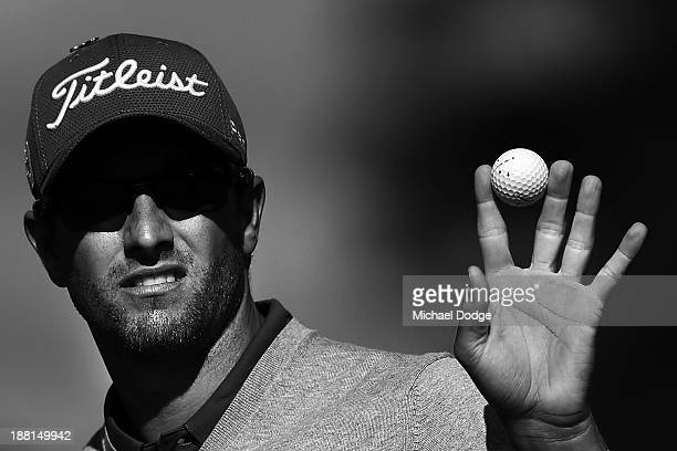 Adam Scott of Australia waves to the crowd on the 18th hole during round three of the 2013 Australian Masters at Royal Melbourne Golf Course on...