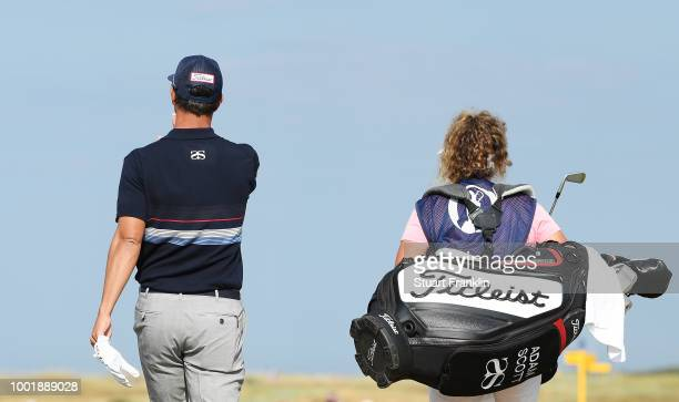 Adam Scott of Australia with his caddie Fanny Sunesson during the first round of the 147th Open Championship at Carnoustie Golf Club on July 19 2018...