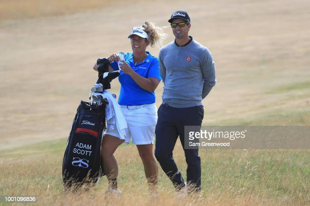 Adam Scott of Australia with his caddie Fanny Sunesson on the 14th hole during previews to the 147th Open Championship at Carnoustie Golf Club on...