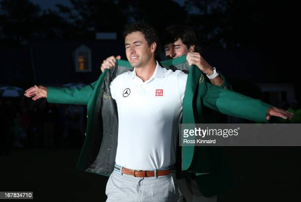 Adam Scott of Australia with the Green Jacket after winning the Masters during the final round of the 2013 Masters at the Augusta National Golf Club...
