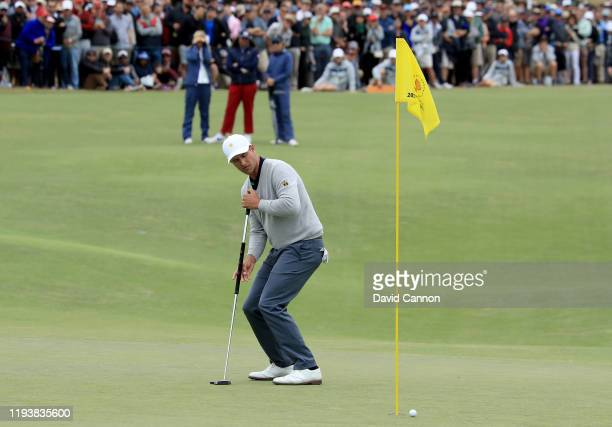 Adam Scott of the International Team just misses a birdie chance on the 18th hole in his match with Byeong Hun An against Tony Finau and Matt Kuchar...