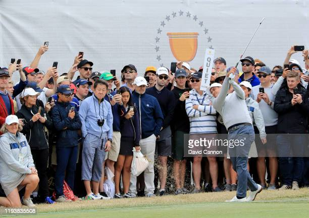 Adam Scott of the International Team plays his second shot on the 16th hole in his match with Byeong Hun An against Tony Finau and Matt Kuchar of the...