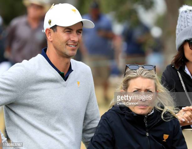 Adam Scott of the International watcheds the later matches with his wife Marie Kojzar during the afternoon fourball matches in the 2019 Presidents...