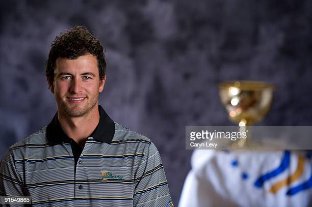 Adam Scott poses with the trophy at The Fairmont before practice for The Presidents Cup at Harding Park Golf Club on October 5 2009 in San Francisco...