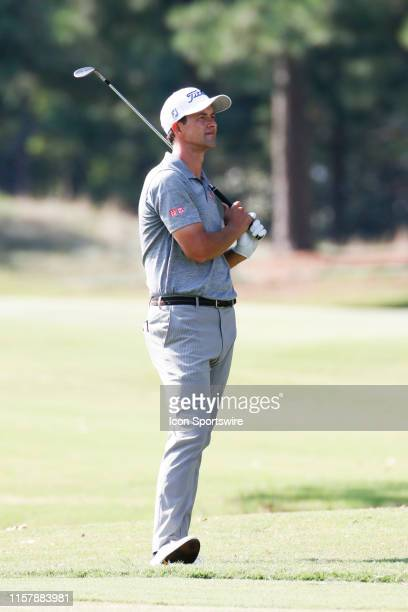 Adam Scott reacts after a shot from the seventh fairway during the second round of the World Golf Championships - FedEx St. Jude Invitational on July...