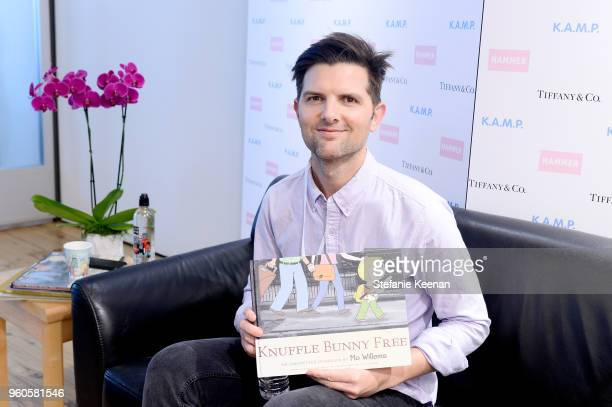 Adam Scott reads to children at the Hammer Museum KAMP 2018 at Hammer Museum on May 20 2018 in Los Angeles California