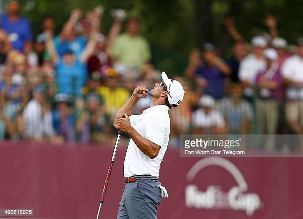 Adam Scott sinks a birdie putt on No. 18 to win the Crowne Plaza Invitational at Colonial in Fort Worth, Texas, Sunday, May 25, 2014.