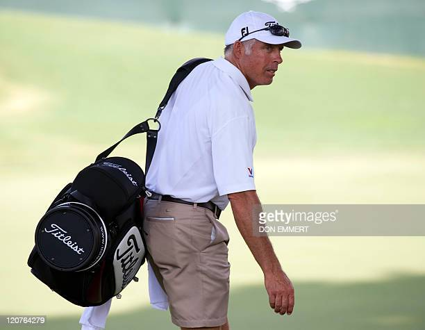 Adam Scott's caddy Steve Williams near the 18th green during a practice round of the 2011 PGA Championship Tournament at Atlanta Athletic Club August...